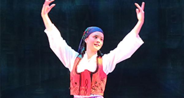 Young female dancer on stage