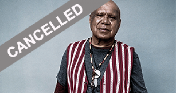 A portrait photo of Archie Roach looking calm and wearing a stripy vest