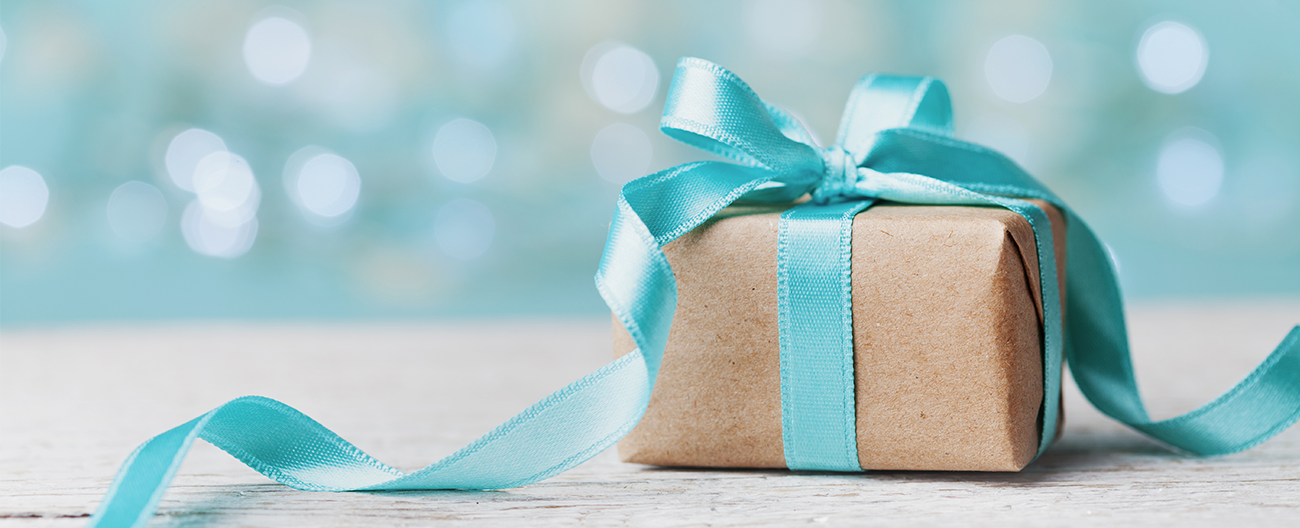Small square brown gift wrapped in aqua ribbon
